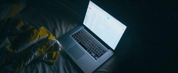 laptop-on-bed-in-dark-room.jpg