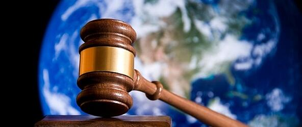 gavel-in-front-of-globe-600x250.jpg