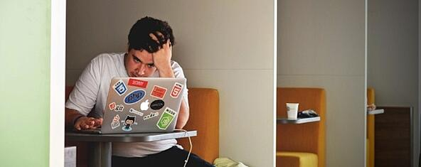 man-thinking-while-looking-at-laptop-screen-600x238.jpg